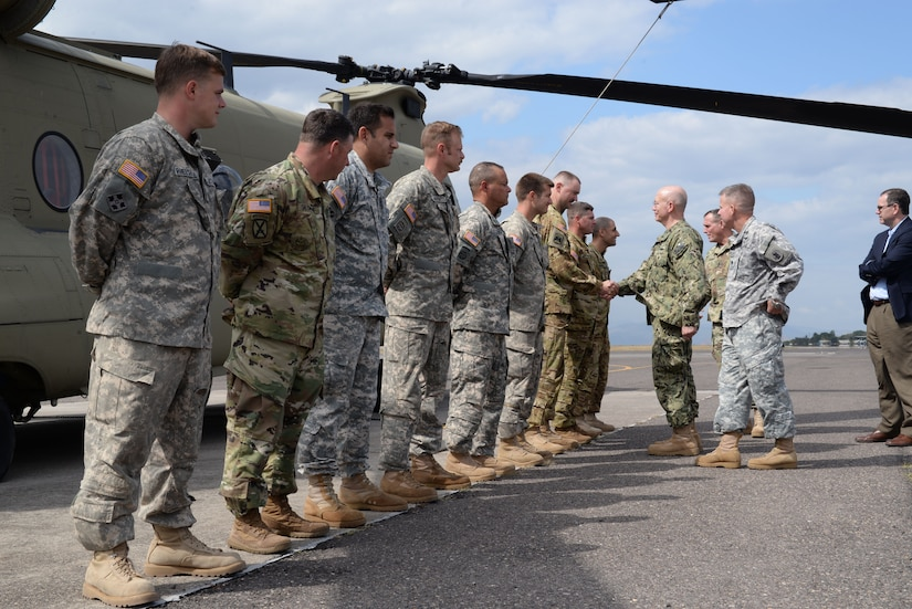 U.S. Navy Adm. Kurt W. Tidd, Southern Command commander speaks with members of Joint Task Force-Bravo during his visit to Soto Cano Air Base, Honduras, Jan. 22, 2016. Tidd's visit gave him the opportunity to gain a better understanding of JTF-Bravo's mission set and to reach out and receive feedback from the men and women that serve to protect the United States from afar. (U.S. Air force photo by Senior Airman Westin Warburton/Released)