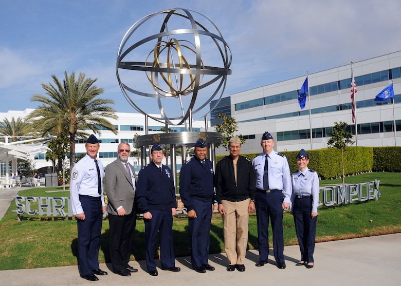 U.S. Navy Adm. Cecil D. Haney (center right), U.S. Strategic Command commander, stands with U.S. Air Force Lt. Gen. Samuel A. Greaves (center), Space and Missile Systems Center commander and Air Force program executive officer for space and other USSTRATCOM and SMC personnel in front of the Armillary (aka the 'Space Motif'), a landmark within SMC's Schriever Space Complex at Los Angeles Air Force Base, El Segundo, Calif., Jan. 20, 2016. SMC, part of the Air Force Space Command, is responsible for the research, development, acquisition on-orbit testing and sustainment of military space and missile systems. Air Force Space Command is a service component of USSTRATCOM. Haney visited SMC to gain a better understanding of the command and its missions. One of nine Department of Defense unified combatant commands, USSTRATCOM has global strategic missions, assigned through the Unified Command Plan, which include strategic deterrence; space operations; cyberspace operations; joint electronic warfare; missile defense; intelligence, surveillance and reconnaissance; combating weapons of mass destruction; and analysis and targeting. (U.S. Air Force photo/Van Ha)