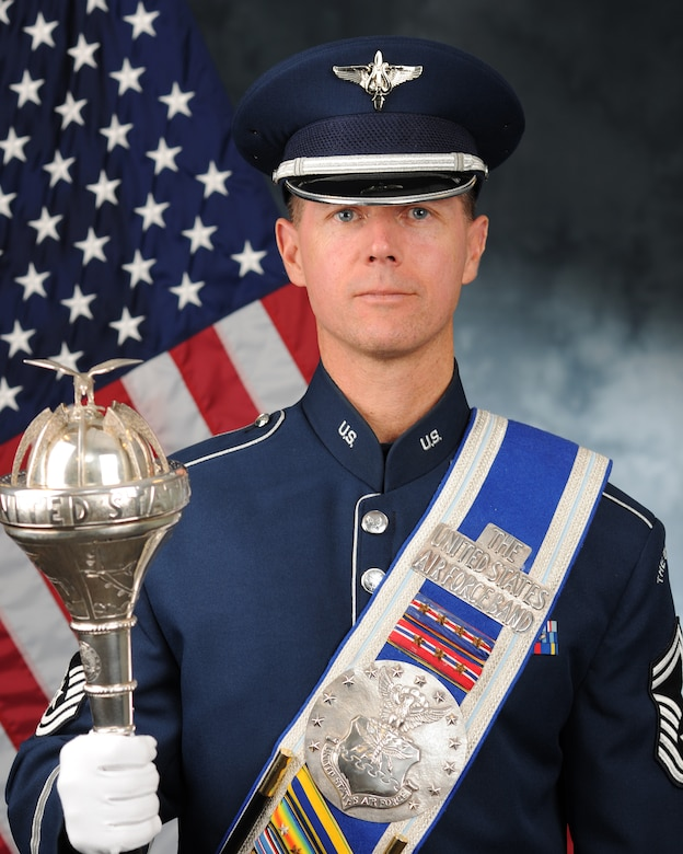 An Air Force drum major poses for an official portrait.