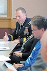 """Brig. Gen. John Kolasheski, the 1st Infantry Divisions deputy commanding general for maneuver, talks about ways the """"Big Red One"""" and University of Kansas can partner to benefit their communities Nov. 23 on campus in Lawrence. Leaders from the 1st Inf. Div. met with KU educators and administrators to formalize a partnership resolution between the two organizations."""