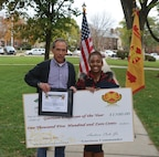 """Brittany Toombs, program assistant for Child, Youth and School Services at Fort Riley, was named Garrison Employee of the Year during the Garrison Awards Ceremony at Ware Parade Field Oct. 30. """"I think it (is) something that was very well deserved for her … a long-time very dedicated employee of CYSS,"""" said Danitta Brantley, director of Forsyth East Child Development Center. """"She is that one employee who you can really count on to give you the knowledge if you need it and help others to learn."""""""