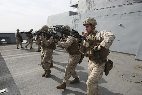 U.S. Marines with Fox Company, Battalion Landing Team 2/6, 26th Marine Expeditionary Unit (26th MEU), conduct speed reload drills aboard the amphibious transport dock ship USS Arlington (LPD 24), Jan 22, 2016. The 26th MEU is embarked with the Kearsarge Amphibious Ready Group and is deployed to maintain regional security in the U.S. 5th Fleet area of operations. (U.S. Marine Corps photo by Cpl. Jeraco Jenkins/26th MEU Combat Camera/Released)