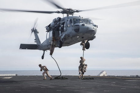 U.S. Marines with Fox Company, 2nd Battalion, 1st Marine Regiment and the Maritime Raid Force with the 13th Marine Expeditionary Unit, fast rope from a CH-60 Seahawk with Helicopter Sea Combat Squadron 23 aboard the USS Boxer off the coast of southern California during their Sustainment Exercise Jan. 17, 2016. SUSTEX is designed to reinforce the Boxer Amphibious Ready Group/MEU's execution of mission essential tasks in preparation for their upcoming deployment. (U.S. Marine Corps photo by Sgt. Tyler C. Gregory/released)