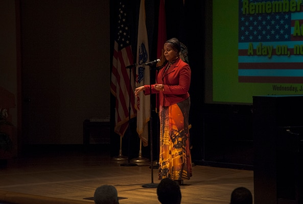 """Defense Supply Center Columbus celebrated the life and legacy of Dr. Martin Luther King Jr. Jan. 20 inside DLA Land and Maritime's Building 20 auditorium. Ms. Anita Jones, a Product Specialist in Maritime Supplier operations, performed a """"Poetic Oratorical,"""" urging those in attendance to exemplify the """"power of the collective."""""""
