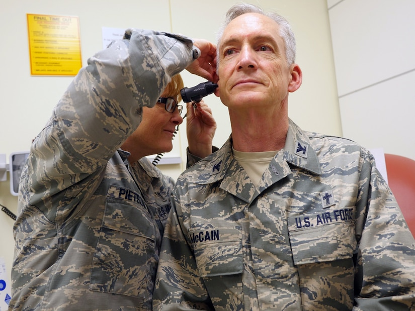 Air Force Col. (Dr.) Kimberly Pietszak, interim chief, Department of Quality Services, and assistant chief, Department of Medicine, examines Air Force Col. Patrick McCain at San Antonio Military Medical Center, Aug 26, 2015.  Getting regular checkups are vital step in maintaining one's Individual Medical Readiness and aids an Airman's ability to support the mission. (U.S. Air Force photo by Corey Toye)