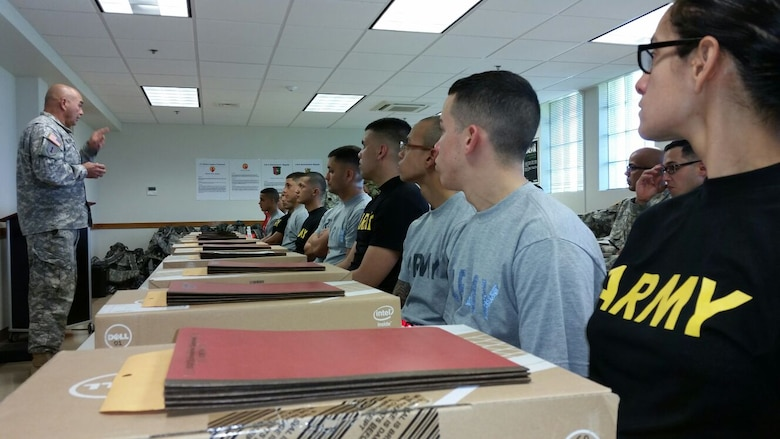 1st Sgt. Daniel Cuevas from the 1/389th Regiment (Drill Sergeant) explains some administrative notes to the competitors before the start of the 77th Combat Sustainment Battalion (CSSB)Best Warrior Competition held 22-24 January at Ramey Base, Aguadilla, Puerto Rico
