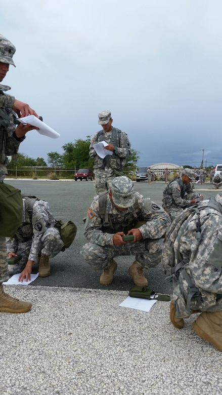 Competitors input grid coordinates into their DAGRs before beginning the land navigation event of the 77th CSSB Best Warrior Competition held 22-24 January at Ramey Base, Aguadilla, Puerto Rico.