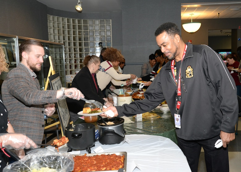 Tyler Yell, a student in Installation Support and Programs Management, serves a variety of food to U.S. Army Engineering and Support Center, Huntsville employees during the Dr. Martin Luther King Jr. Unity Day Celebration Jan. 22.