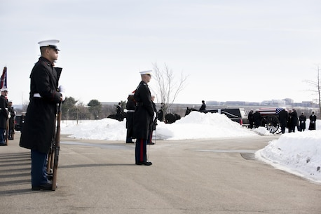Marines from Marine Barracks Washington, D.C., stand at ceremonial at ease during a funeral for a Vietnam War and Marine Corps veteran at Arlington National Cemetery, Va., Jan. 26, 2016. (Official Marine Corps photo by Cpl. Chi Nguyen/Released)
