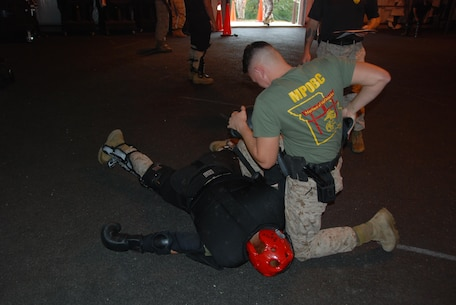 MPOBC student uses arm bar takedown during OC drills.