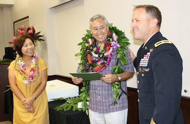 USACE Pacific Ocean Division Commanding General, Brig. Gen. Jeffrey Milhorn, congratulates Gary Kitkowski and his wife, Eri, on Kitkowski's appointment to the Senior Executive Service and selection for the position of Director of Regional Business for POD. Friends, co-workers, current and former POD leaders gathered at the POD headquarters at Fort Shafter, Hawaii Jan. 21 to honor the new SES leader.