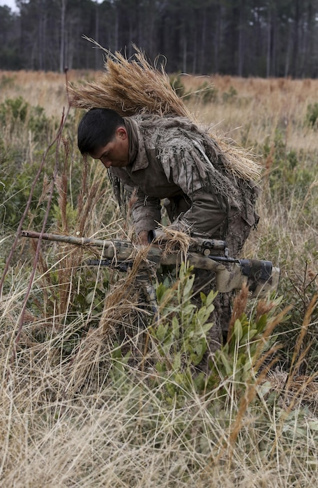 Corporal Brighten Bell, a student undergoing the 2nd Marine Division Combat Skills Center Pre-Scout Sniper Course, prepares to move during a stalking exercise at Camp Lejeune, N.C., Jan. 22, 2016. The DCSC offers several infantry-based courses to enhance the combat readiness of its Marines. (U.S. Marine Corps photo by Cpl. Paul S. Martinez/Released)