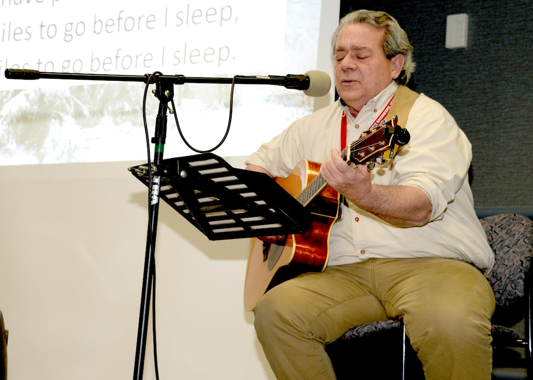 """Benny Pitsinger, Huntsville Center Engineering Directorate, plays a song he wrote for the Dr. Martin Luther King Jr. Unity Day Celebration called """"The Hyphenated American."""""""