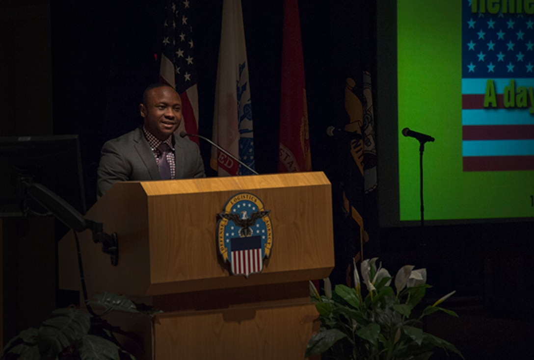 The guest speaker at Defense Supply Center Columbus celebration of the life and legacy of Dr. Martin Luther King Jr. was Emmanuel Olawale, a trial lawyer in the Columbus area. Olawale described how his life story is a testament that the American Dream is not just a fantasy, but a reality.
