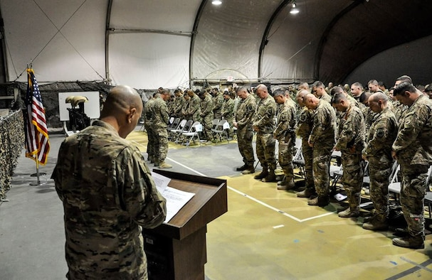 Service members from several units at Bagram Airfield, Afghanistan pay their respects during a fallen comrade ceremony held in honor of six Airmen Dec. 23, 2015. The six Airmen lost their lives in an improvised explosive attack near Bagram Dec. 21, 2015. (U.S. Air Force photo by Tech. Sgt. Nicholas Rau)