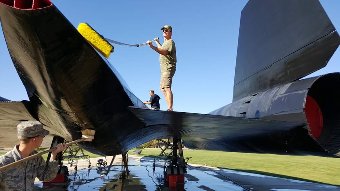 Members of Team Beale and Blackbird Maintainers clean the SR-71 static display at Beale Air Force Base, California. (Courtesy photo)