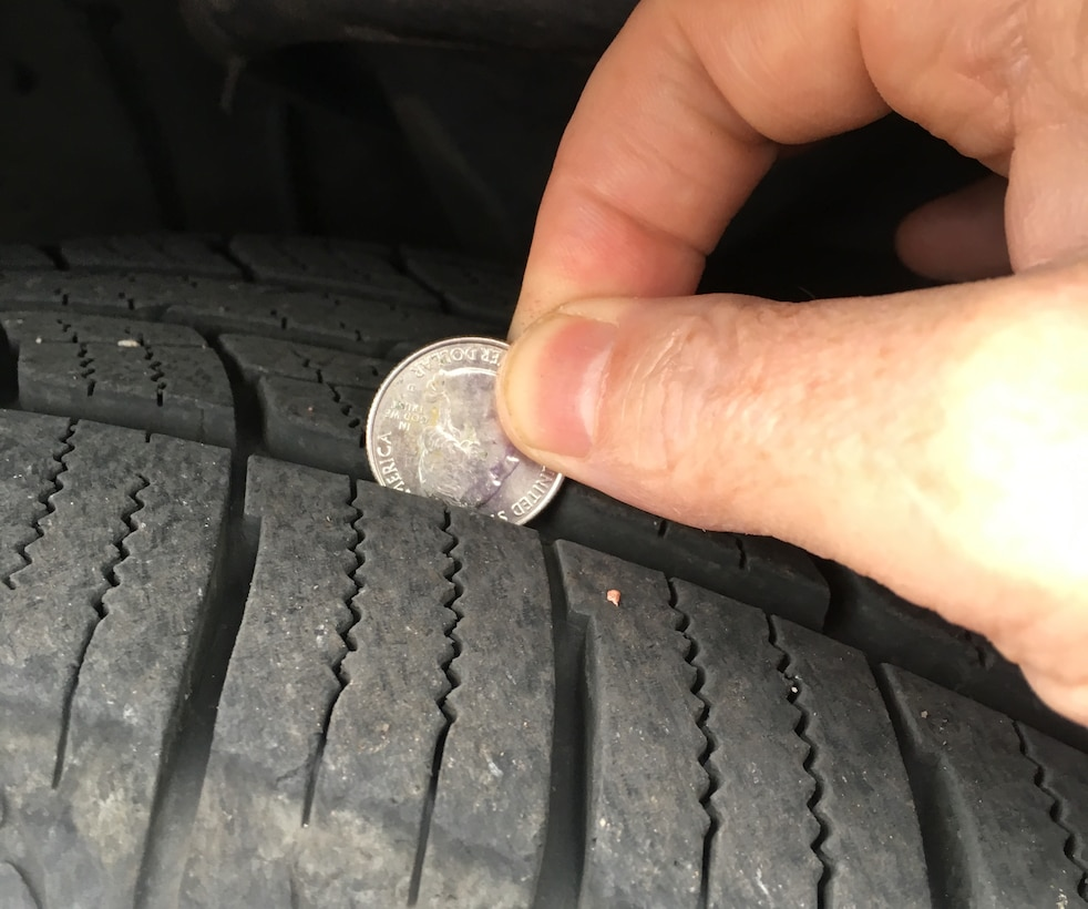 PETERSON AIR FORCE BASE, Colo. – Making sure tire tread is at least 1/8 inch deep is crucial for safe winter driving. Experts suggest the quarter test, where a quarter is inserted into the tread a various spots on the tire. If the top of George Washington's head is covered your tread is good to go. (U.S. Air Force photo by Dave Smith)
