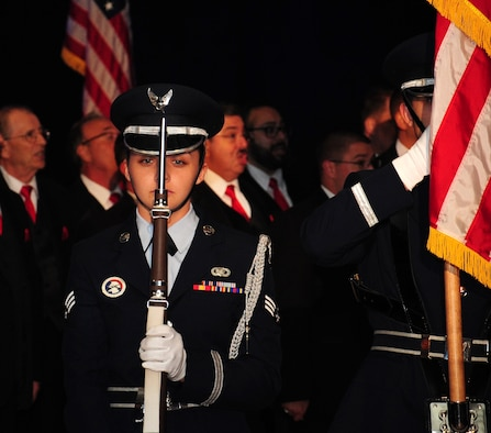 Senior Airman Tori Schultz, an honor guardsman assigned to the 6th Air Mobility Wing (AMW), presents arms as the front rifle guard during a ceremony, Oct. 2, 2015 in Tampa, Fla. The 6th AMW base honor guard performs color details and military honors at funerals for veterans in the local area. (U.S. Air Force photo by Senior Airman Jenay Randolph)