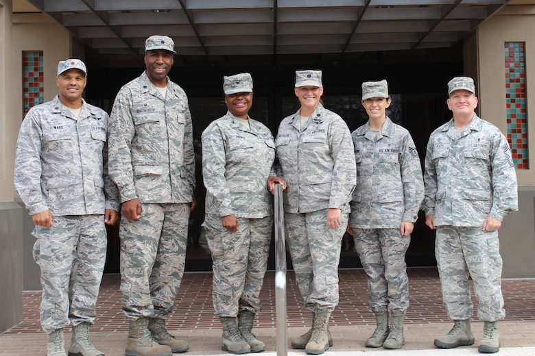 Leaders from the 9th Space Operations Squadron and 30th Medical Squadron, respectively, pose for a photo in front of the 30th MDG building, Sept. 12, 2015, Vandenberg Air Force Base, Calif. In the spirit of partnership and Total Force teamwork, the 9 SOPS and the 30th MDG collaborated to utilize the clinic facility during Unit Training Assembly, also known as drill weekend, for local Reservists. (Courtesy photo)