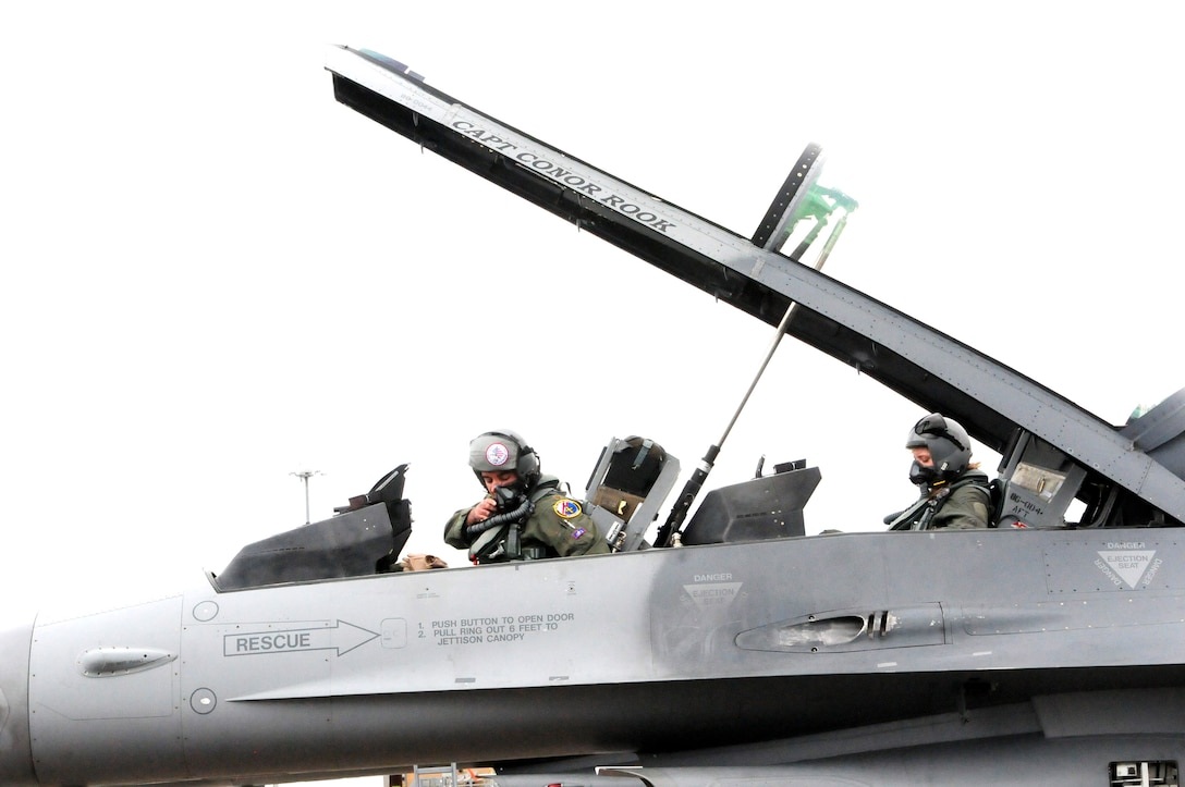 A 121st Fighter Squadron, Joint Base Andrews, Md., pilot prepares for a familiarization flight aboard an F-16D at Naval Air Station Joint Reserve Base New Orleans, La., in support of Exercise Operation Sentry Voodoo 2016. More than 200 D.C. Air National Guard Airmen are participating in the two-week multiple unit/aircraft exercise. (Air National Guard photo by Master Sgt. Craig Clapper/Released)