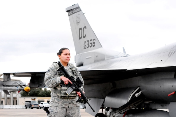 113th Wing security forces specialist Senior Airman Erica Gonzalez patrols the flight line on Naval Air Station Joint Reserve Base, New Orleans during Exercise Sentry Voodoo 2016. Gonzalez is a D.C. Air National Guardsman participating in the two-week flying exercise. (Air National Guard photo by Master Sgt. Craig Clapper/Released)