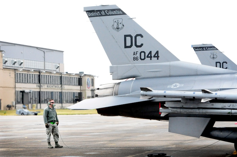 Staff Sgt. Samuel Baughman, crew chief, 113th Wing, Joint Base Andrews, Md., prepares an F-16 for a flying sortie at Naval Air Station Joint Reserve Base New Orleans, La., during Exercise Sentry Voodoo 2016. The D.C. Air National Guard Airmen are participating in the two-week flying exercise along with the 159th Fighter Wing, Louisiana Air National Guard, and the 459th Air Refueling Wing, Joint Base Andrews, Md. (Air National Guard photo by Master Sgt. Craig Clapper/Released)