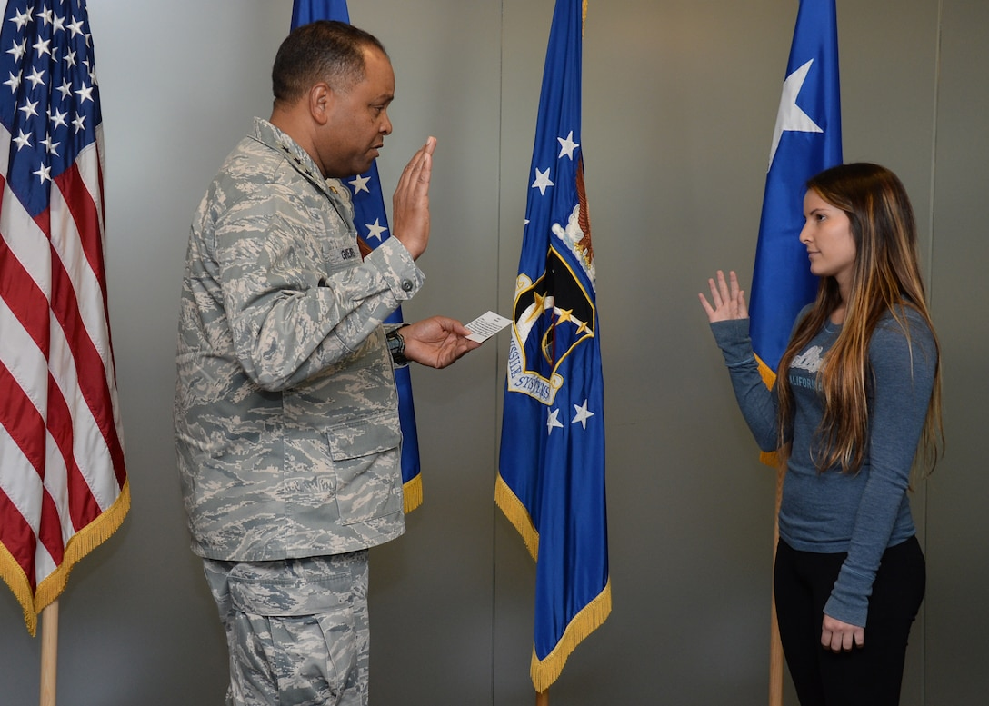 Lt. Gen. Samuel Greaves, Space and Missile Systems Center commander and Air Force program executive officer for space, conducts an impromptu swearing-in ceremony with Air Force Reserve recruit Jennie Ines. The event transpired as the result of a chance meeting the previous December by the Exchange at Los Angeles Air Force Base in El Segundo, Calif. (U.S. Air Force photo/Van Ha)