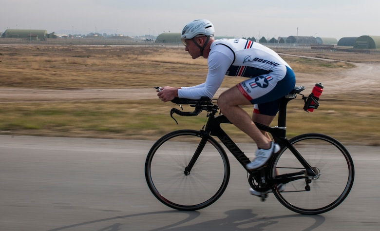 U.S. Air Force Senior Master Sgt. Jason Chiasson, 39th Communications Squadron production superintendent, trains for the Air Force Cycling team Dec. 10, 2015, at Incirlik Air Base, Turkey. Chiasson regularly rides laps around the flightline to achieve 25 to 100 miles per training session. (U.S. Air Force photo by Senior Airman Krystal Ardrey/Released)