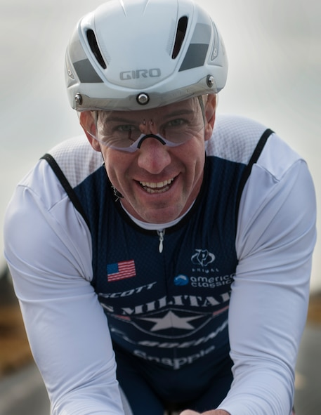 U.S. Air Force Senior Master Sgt. Jason Chiasson, 39th Communications Squadron production superintendent, cycles past the fight line Dec. 10, 2015, at Incirlik Air Base, Turkey. Chiasson is a member of the Air Force Cycling Team and regularly rides multiple laps around the flightline to train for longer endurance rides. (U.S. Air Force photo by Senior Airman Krystal Ardrey/Released)