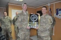 Brig. Gen. Christopher Craige, TAAC-Air commanding general, receives the Secretary of Defense Award for Excellence in Maintenance Training, Advice, and Assistance of Foreign Security Forces from Col. Scott Grover, TAAC-Air CJ4 deputy commander, Jan. 20, 2016. TAAC-Air personnel advised the Afghan Air Force Kabul Air Wing and Kandahar Air Wing on maintaining fixed and rotary wing aircraft. The AAF's accomplishments last year include nearly 15,000 flight hours completed, 41,000 troops moved and 2,200 casualties evacuated. (U.S. Air Force photo by Capt. Eydie Sakura/released)