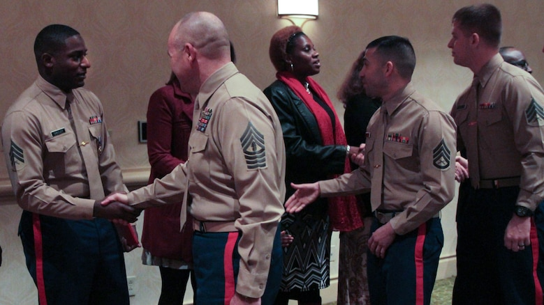 Marines congratulate Sgt. DeMonte R. Cheeley on receiving the Purple Heart medal Jan. 26, 2016, at a ceremony in Chattanooga, Tenn. Cheeley received the Purple Heart for injuries he sustained during a July 16, 2015 attack in Chattanooga at the Armed Forces Career Center where he works. Cheeley is a Marine recruiter with Recruiting Substation Chattanooga, Recruiting Station Nashville, Tenn.