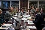 Command Sgt. Maj. Charles Tobin along with USTRANSCOM Command Sgt. Maj. William Turner and Army Sgt. Maj. Rodger Mansker visited DLA Distribution leadership on Jan. 20.