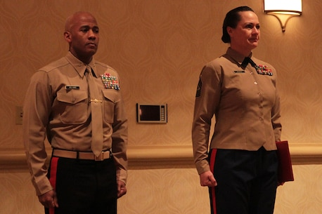 Brig. Gen. Terry V. Williams and Sgt. Maj. Angela M. Maness stand at attention before awarding Sgt. DeMonte R. Cheeley the Purple Heart medal Jan. 26, 2016, at a ceremony in Chattanooga, Tenn. Cheeley received the Purple Heart for injuries he sustained during a July 16, 2015 attack in Chattanooga at the Armed Forces Career Center where he works. An investigation conducted by the FBI and the Naval Criminal Investigative Service determined the attack had been inspired by a foreign terrorist group making Cheeley eligible for the Purple Heart. Cheeley is a Marine recruiter with Recruiting Substation Chattanooga, Recruiting Station Nashville, Tenn. Williams is the Commanding General of Marine Corps Recruit Depot Parris Island and Eastern Recruiting Region. Maness is the Sergeant Major of Marine Corps Recruit Depot Parris Island and Eastern Recruiting Region. (Official Marine Corps photo by Cpl. Diamond N. Peden/Released)