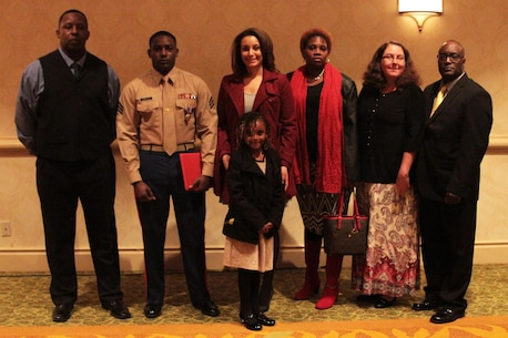 Sgt. DeMonte R. Cheeley stands with his family after receiving the Purple Heart medal Jan. 26, 2016, at a ceremony in Chattanooga, Tenn. Cheeley received the Purple Heart for injuries he sustained during a July 16, 2015 attack in Chattanooga at the Armed Forces Career Center where he works. An investigation conducted by the FBI and the Naval Criminal Investigative Service determined the attack had been inspired by a foreign terrorist group making Cheeley eligible for the Purple Heart. Cheeley is a Marine recruiter with Recruiting Substation Chattanooga, Recruiting Station Nashville, Tenn. (Official Marine Corps photo by Cpl. Diamond N. Peden/Released)