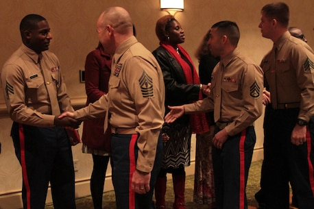 Marines congratulate Sgt. DeMonte R. Cheeley on receiving the Purple Heart medal Jan. 26, 2016, at a ceremony in Chattanooga, Tenn. Cheeley received the Purple Heart for injuries he sustained during a July 16, 2015 attack in Chattanooga at the Armed Forces Career Center where he works. Cheeley is a Marine recruiter with Recruiting Substation Chattanooga, Recruiting Station Nashville, Tenn. (Official Marine Corps photo by Cpl. Diamond N. Peden/Released)
