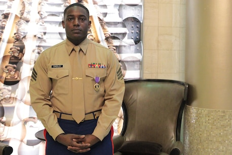 Sgt. DeMonte R. Cheeley stands for a photo after receiving the Purple Heart medal Jan. 26, 2016, at a ceremony in Chattanooga, Tenn. Cheeley received the Purple Heart for injuries he sustained during a July 16, 2015 attack in Chattanooga at the Armed Forces Career Center where he works. An investigation conducted by the FBI and the Naval Criminal Investigative Service determined the attack had been inspired by a foreign terrorist group making Cheeley eligible for the Purple Heart. Cheeley is a Marine recruiter with Recruiting Substation Chattanooga, Recruiting Station Nashville, Tenn. (Official Marine Corps photo by Cpl. Diamond N. Peden/Released)