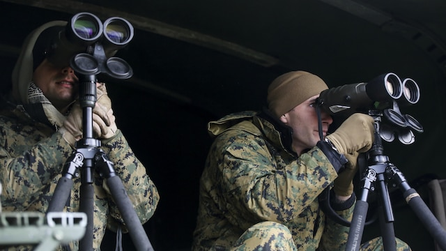Sergeants Douglas Cairn, left, and Bradley Brouwer, right, instructors in the 2nd Marine Division Combat Skills Center's Pre-Scout Sniper Course, search for students during a stalking exercise at Marine Corps Base Camp Lejeune, North Carolina, Jan. 22, 2016. The DCSC offers several infantry-based courses to enhance the combat readiness of its Marines.