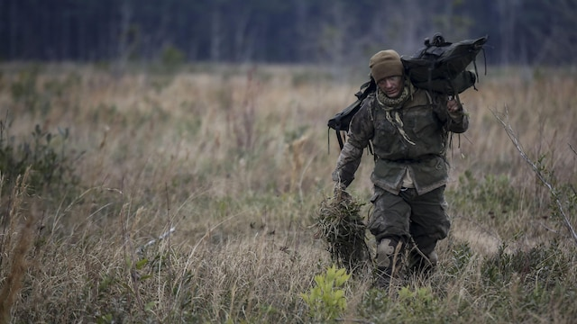 A Marine student undergoing the 2nd Marine Division Combat Skills Center's Pre-Scout Sniper Course departs a field following a stalking exercise at Marine Corps Base Camp Lejeune, North Carolina, Jan. 22, 2016. The DCSC offers several infantry-based courses to enhance the combat readiness of its Marines.