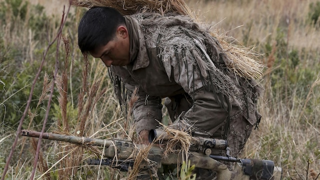 Corporal Brighten Bell, a student undergoing the 2nd Marine Division Combat Skills Center Pre-Scout Sniper Course, prepares to move during a stalking exercise at Marine Corps Base Camp Lejeune, North Carolina, Jan. 22, 2016. The DCSC offers several infantry-based courses to enhance the combat readiness of its Marines.