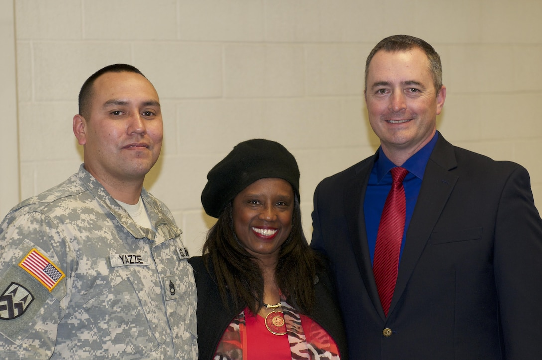 Dr. Karen Johnson, associate professor of education at the University of Utah, poses for a group photo with equal opportunity advisers Sgt. 1st Class William Yazzie and Greg Rogers during a Black History Month observance held at Fort Douglas, Utah, Feb. 25. The purpose of the event was to spread cultural awareness and provide a history lesson on the role of the African-American female during the Civil War. (U.S. Army photo by Capt. Chad M. Nixon)