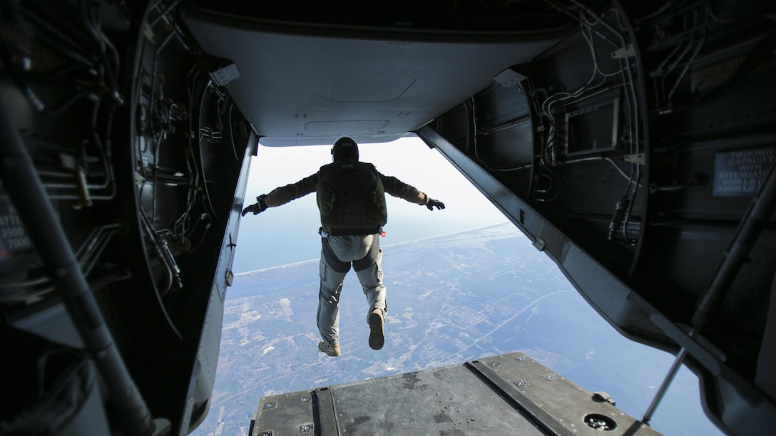 A Marine with U.S. Marine Corps Forces, Special Operations Command jumps out of the back of an MV-22B Osprey at a height of 13,000 feet with Marine Medium Tiltrotor Squadron 365 at Marine Corps Air Station New River, North Carolina, Jan. 21, 2016. The squadron supported Marine Raiders by conducting high altitude low opening jumps, which are jumps at a height of around 13,000 feet, as well as static line jumps, which are jumps at a height of around 4,000 feet, to allow MARSOC Marines to train for future operations.