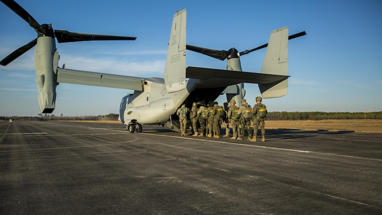 Marines with U.S. Marine Corps Forces, Special Operations Command board an MV-22B Osprey to conduct parachute operations with Marine Medium Tiltrotor Squadron 365 at Marine Corps Air Station New River, North Carolina, Jan. 21, 2016. The squadron supported Marine Raiders by conducting high altitude low opening jumps as well as static line jumps to allow Marine Raiders to train for future operations.