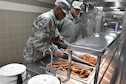 Senior Airman Kyle Slaughter, a food services specialist with the 910th Force Support Squadron, prepares country fried steak for lunch here, Jan. 10, 2016. The Force Support Squadron serves five meals for approximately 1300 airmen during unit training assembly weekends. (U.S. Air Force photo/ Tech. Sgt. Rick Lisum)