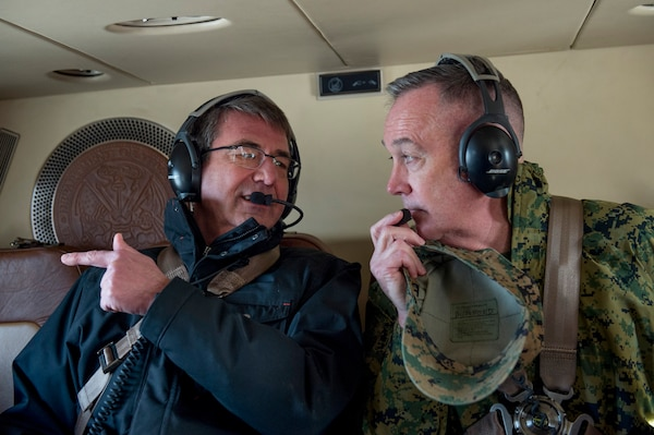 Defense Secretary Ash Carter and Marine Corps Gen. Joseph F. Dunford Jr., chairman of the Joint Chiefs of Staff, talk on helicopter headsets on their way back to the Pentagon after a visit to U.S. Cyber Command headquarters on Fort George G. Meade, Md., Jan. 27, 2016. DoD photo by Air Force Senior Master Sgt. Adrian Cadiz