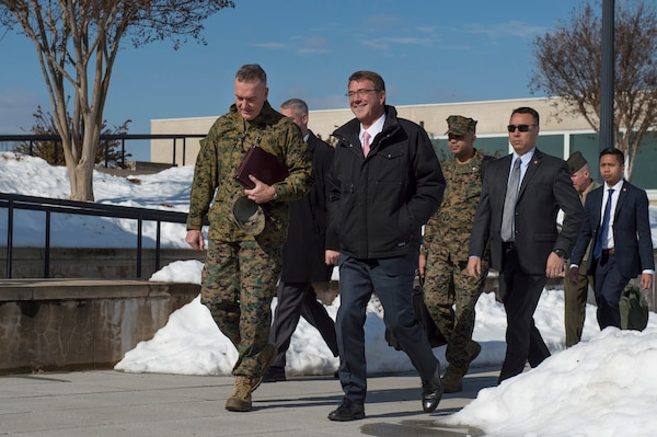 Defense Secretary Ash Carter walks with Marine Corps Gen. Joseph Dunford, chairman of the Joint Chiefs of Staff, as they return to the Pentagon after a visit to U.S. Cyber Command headquarters on Fort George G. Meade, Md, Jan. 27, 2016. The defense leaders met with Cybercom commander, Adm. Michael S. Rogers. DoD photo by Air Force Senior Master Sgt. Adrian Cadiz