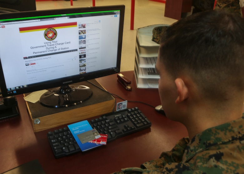 A Marine watches a YouTube video describing the details of Marine administrative message 001/16, which states that all permanent change of station travel expenses will now be paid using the government travel charge card. This change is expected to make travel more efficient and cost effective and to protect Marines from being charged interest on their personal accounts. For more information, watch the video at https://youtu.be/V7WMkMVX8GQ or contact your unit agency program coordinator. (U.S. Marine Corps photo by Cpl. Michelle Reif/Released.)