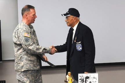 """Brig. Gen. Frederick R. Maiocco, Jr., left, commanding general, 85th Support Command and deputy commanding general, First Army Division West; meets Oscar Lawton """"Wilk"""" Wilkerson, local Chicagoan and Tuskegee Airman, during an African American/Black History Month unit observance, at the 85th Support Command's headquarters, Feb. 7. During the observance, Wilkerson discussed his experiences in the service and held a questions and answers portion with the soldiers there. (U.S. Army photo by Spc. David Lietz/Released)"""