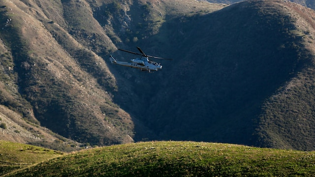 Joint Tactical Attack Controllers conduct training by directing an AH-1W Super Cobra to targets along the hill sides of Marine Corps Base Camp Pendleton, California, Jan. 13, 2016. The Super Cobra uses its three barrel 20mm cannon and launches various rackets to hit its mark with precision. The Marines are with 1st Air Naval Gunfire Liaison Company, I Marine Expeditionary Force.
