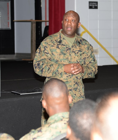 Sgt. Maj. Robert Green, sergeant major of the Marine Corps, addresses Marines and Sailors during his first visit to Marine Corps Logistics Base Albany. Green, the 18th SMMC, spoke to the installation's active-duty service members in a Town Hall Meeting held at the Base Theater, Jan. 21.