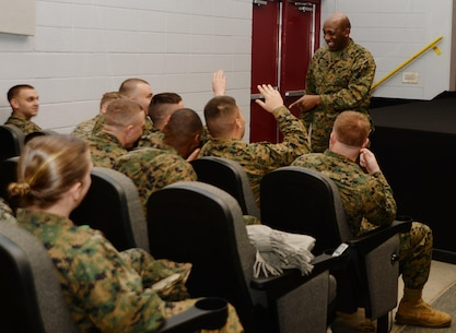 Sgt. Maj. Ronald Green, sergeant major of the Marine Corps, addresses Marines and Sailors during his first visit to Marine Corps Logistics Base Albany. Green, the 18th SMMC, spoke to the installation's active-duty service members in a Town Hall Meeting held at the Base Theater, Jan. 21.